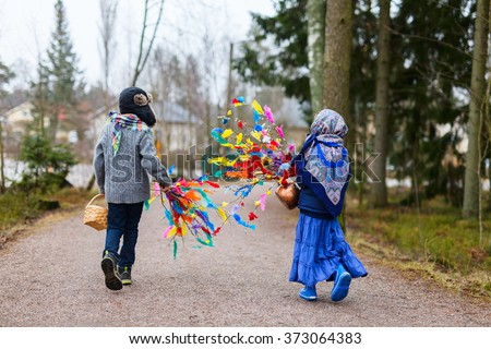 Back view of kids outdoors dressed for Easter traditional celebration in Finland - stock photo