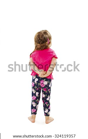 Back view of little baby girl looking at wall. Rear view. Isolated on white background  - stock photo