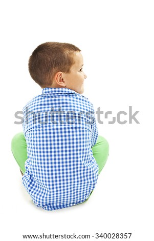 Back view of little boy looking on side. Isolated on white background  - stock photo