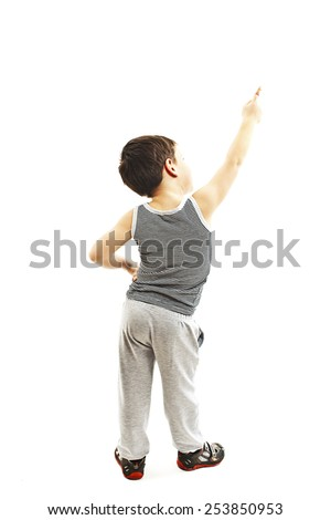 Back view of little boy points at wall. Rear view. Isolated on white background  - stock photo