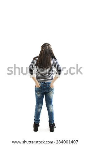 Back view of little girl looking at wall. Rear view. Isolated on white background  - stock photo