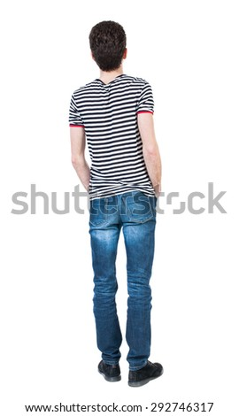 Back view of man in jeans. Standing young guy. Rear view people collection.  backside view of person.  Isolated over white background. A guy in a T-shirt is his hands in the front pockets of his jeans - stock photo
