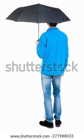 Back view of man in jeans under an umbrella. Standing young guy. Rear view people collection.  backside view of person.  Isolated over white background. Curly boy in the rain. - stock photo
