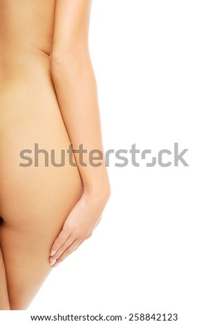 Back view of naked slim woman's buttocks - stock photo