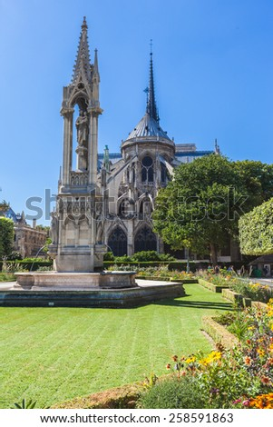 Back view of Notre Dame with garden in Paris, France - stock photo