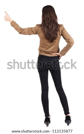 Back view of of beautiful brunette woman in jacket makes thumb up .Showing of positive emotions with OK sign concept. Rear view people collection. backside view person. Isolated over white background. - stock photo