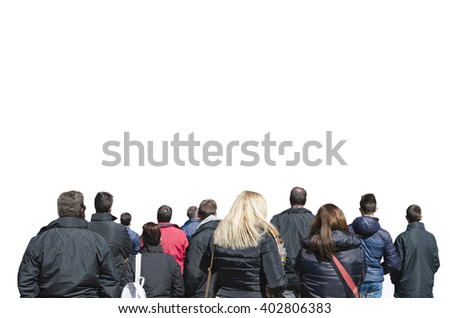 Back view of people watching performance or something. Crowd of spectators - stock photo