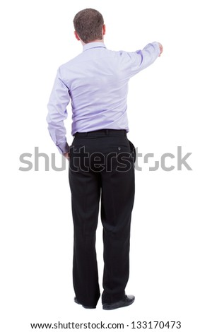 Back view of pointing business man. Rear view people collection.  backside view of person.  Isolated over white background. office worker in a shirt and trousers powerfully indicates something Side - stock photo