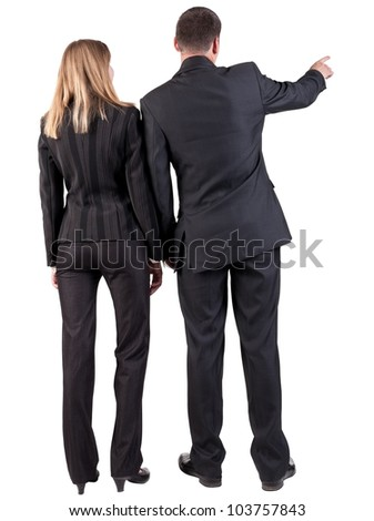 Back view of pointing business team. young couple (man and woman). Beautiful girl and guy in suit together. Rear view people collection.  backside view of person.  Isolated over white background - stock photo