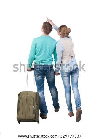 Back view of pointing couple with  green suitcase looking up. Rear view people collection.  backside view of person.  Isolated over white background.  - stock photo