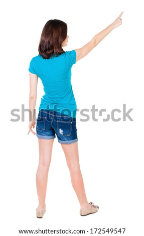 Back view of  pointing woman. beautiful brunette  girl in shorts. Rear view people collection.  backside view of person.  Isolated over white background. - stock photo