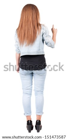 Back view of  pointing woman. beautiful redhead girl in jeans. Rear view people collection.  backside view of person.  Isolated over white background. - stock photo