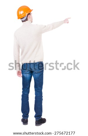 Back view of  pointing young men in helmet. Young guy  gesture. Rear view people collection.  backside view of person.  Isolated over white background. Foreman giving instructions to hand. - stock photo