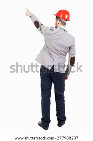 Back view of pointing young men in helmet. Young guy gesture. Rear view people collection. backside view person. Isolated over white background. bearded businessman at construction site refers to top  - stock photo