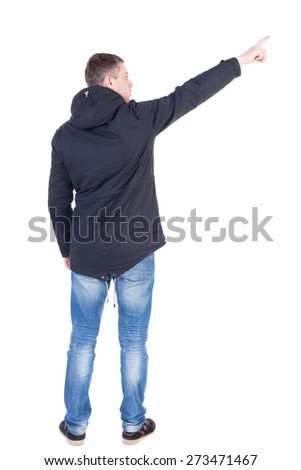 Back view of  pointing young men in parka. Young guy  gesture. Rear view people collection.  backside view of person.  Isolated over white background.  - stock photo