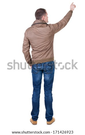 Back view of  pointing young men in  wind breaker. Young guy  gesture. Rear view people collection.  backside view of person.  Isolated over white background.  - stock photo