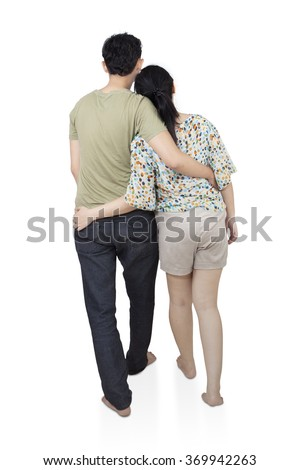 Back view of romantic young couple  hug and look into the distance, isolated on white background - stock photo
