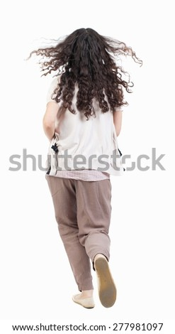 back view of running  woman. beautiful girl in motion. backside view of person.  Rear view people collection. Isolated over white background. curly girl with flowing hair runs - stock photo