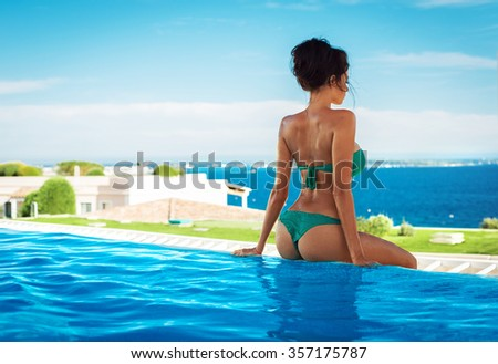 Back view of sexy woman in summer scenery - stock photo