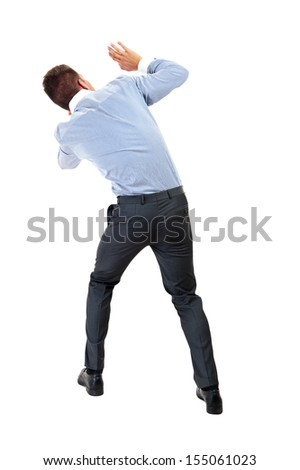 Back view of shocked and scared young business man. Holds hands upwards. Rear view. Isolated over white background - stock photo