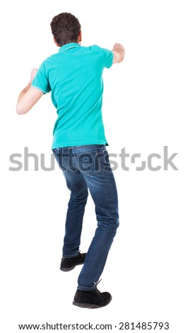 back view of skinny guy funny fights waving his arms and legs. Isolated over white background. Rear view people collection.  backside view of person. Funny guy punches right hand. - stock photo