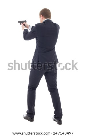 back view of special agent man in business suit posing with gun isolated on white background - stock photo
