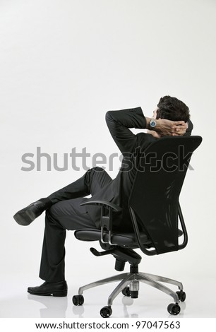 back view of the business relaxing on the chair - stock photo