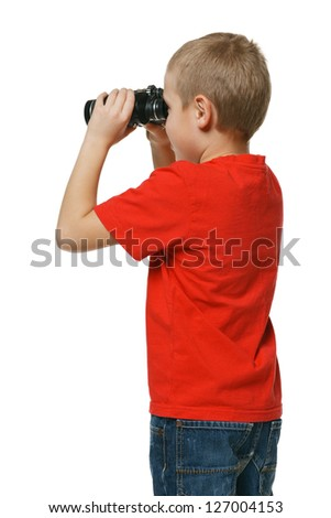 Back view of the six years boy looking away through the binoculars over white background - stock photo