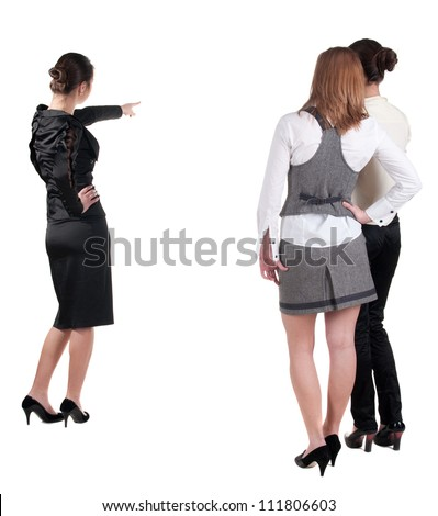 back view of three young business woman pointing. Team work. Rear view people collection.  backside view of person.  Isolated over white background. - stock photo