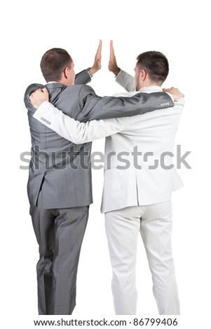 back view of two joyful businessmen with success gesture . Rear view. Isolated over white background. - stock photo