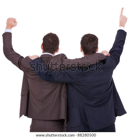 back view of two winning businessmen with their hands in the air over white background - stock photo