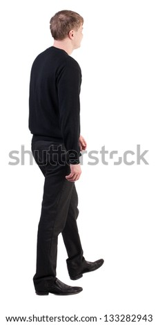 back view of walking  business man. going young guy in red shirt.  Isolated over white background. Rear view people collection.  backside view of person.  dull office worker goes from left to right - stock photo