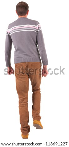 Back view of walking   man in sweater and brown jeans.   young guy in jeans and  jacket. Rear view people collection.  backside view of person.  Isolated over white background. - stock photo