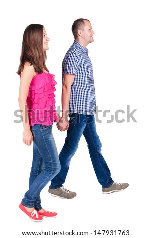 Back view of walking young couple (man and woman). going beautiful friendly girl and guy  together. Rear view people collection. backside view of person. Isolated over white background - stock photo