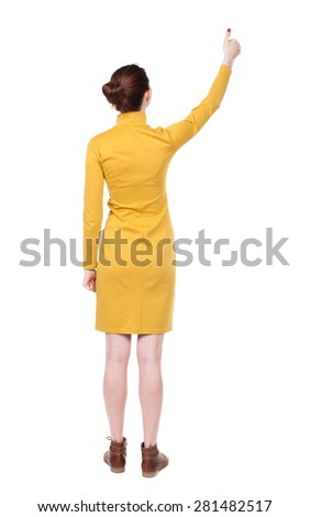 Back view of  woman thumbs up. Rear view people collection. backside view of person. Isolated over white background. Girl in mustard strict dress shows thumb of his right hand. - stock photo