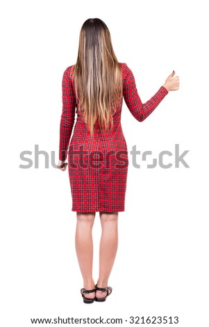 Back view of  woman thumbs up. Rear view people collection. backside view of person. Isolated over white background. The girl in red plaid dress with your right hand thumb up. - stock photo