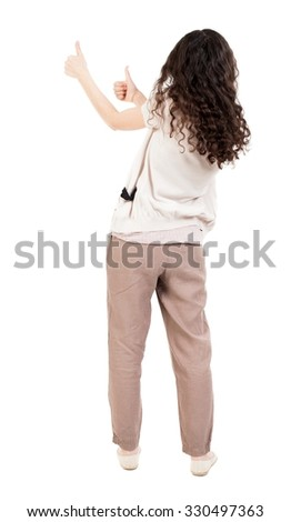 Back view of  woman thumbs up. Rear view people collection. backside view of person. Isolated over white background. A girl with curly hair showing thumbs up with both hands. - stock photo