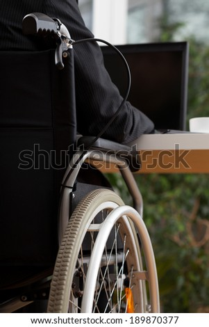 Back view of working man on his laptop - stock photo