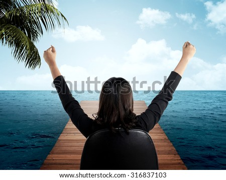 Back view of young asian business person on the wooden pier - stock photo