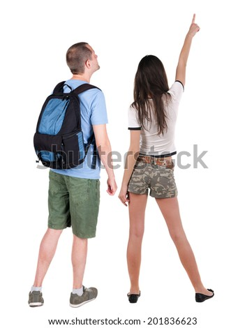 Back view of young couple (man and woman) hug and look into the distance. beautiful friendly girl and guy together. Rear view. Isolated over white background.  - stock photo