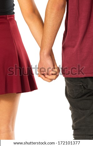 Back view of young couple of sweethearts holding hands over white background - stock photo