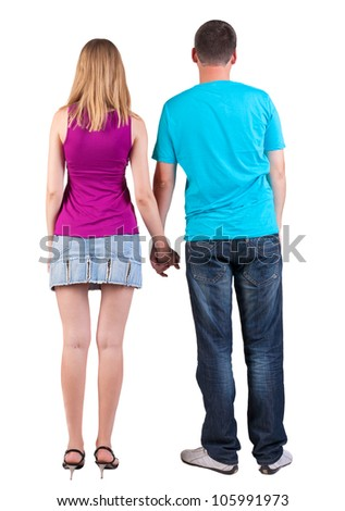 Back view of young embracing couple (man and woman) hug and look. beautiful friendly girl and guy together. Rear view people collection.  backside view of person.  Isolated over white background. - stock photo