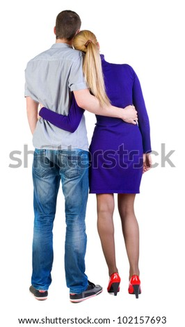 Back view of young embracing couple (man and woman) look into distance. beautiful friendly girl and guy together. Rear view people collection.  backside view of person.  Isolated over white background - stock photo