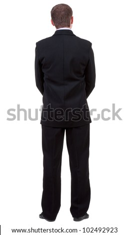 back view of young guy in black suit  watching.   Businessman looks ahead.  Isolated over white background. Rear view people collection. backside view of person. - stock photo