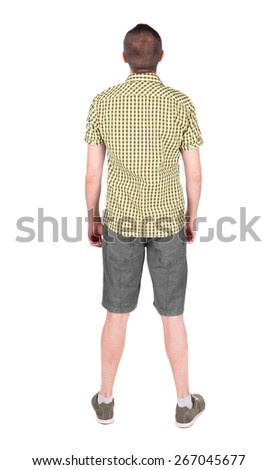 Back view of young man in shirt and shorts  looking.   Standing young guy. Rear view people collection.  backside view of person.  Isolated over white background. - stock photo
