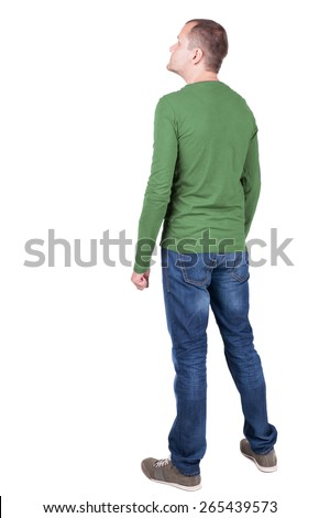 Back view of young man in t-shirt and jeans  looking.   Standing young guy. Rear view people collection.  backside view of person.  Isolated over white background. - stock photo