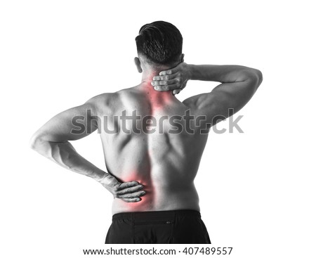 back view of young man with muscular body holding his neck and low back suffering pain in sport spinal injury and fitness stress isolated on black and white with red spot sore area - stock photo