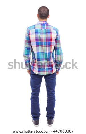 Back view of young man with the hands on the pockets, isolated on white background - stock photo