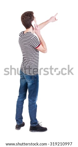 Back view pointing young men talking on cell phone. Young guy  gesture. Rear view people collection.  backside view person.  Isolated over white background. Curly guy on the phone tells what he saw  - stock photo