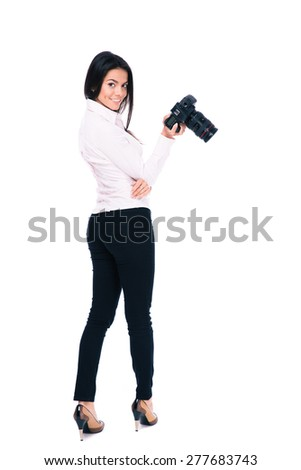 Back view portrait of a happy woman photographer looking at camera. Isolated on a white background - stock photo